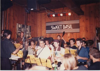 Walter Thompson Orchestra at Sweet Basil NYC 1991 with Dave Tronzo & Rolf Sturm guitars, Tomas Ulrich cello, Allan Chase, Dave CasT, Phillip Johnston, Thomas Chapin saxes, Jim Leff trombone, Steve Bernstein, Herb Robertson, Frank London trumpets, Pablo aslan bass, Hollis Headrick drums, & Walter conducting (Photo by Diana Winsemius)